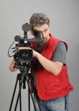 röd vest för cameraman Arkivbilder