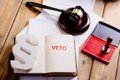 Röd vetostämpel i notepad Fotografering för Bildbyråer