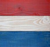 Röd vit- och blåttbrädebakgrund Royaltyfri Bild