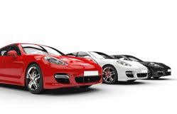 Röd vit och svarta snabba bilar Royaltyfri Bild