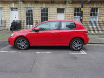 Röd Volkswagen Golf bil Royaltyfria Bilder