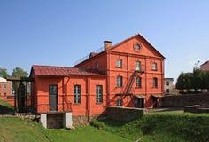 Röd watermillbyggnad Fotografering för Bildbyråer