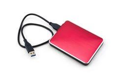Röd yttre hårddisk med usb-kabel Arkivfoto