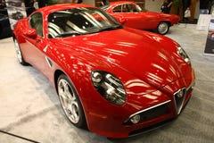 Röda Alfa Romeo på Toronto den auto showen 2013 Arkivbilder