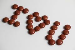 Röda bestrukna choklader älskar jag dig Royaltyfri Fotografi