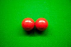 Röda bollar för Snook två. Arkivbild