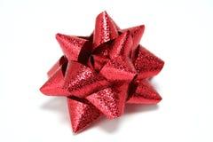 röda celebratory gåvor för bow Arkivbild