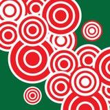 Röda cirklar och grön bakgrund Royaltyfria Foton