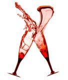 Röda coctailar med färgstänk Royaltyfri Foto