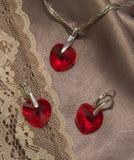 Röda cristal smycken - örhängen och medaljong Fotografering för Bildbyråer