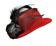 Röda dams för tappning hatt med svarta fjädrar Royaltyfri Fotografi