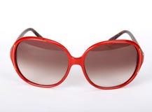 Röda exponeringsglas för en sol Arkivfoto