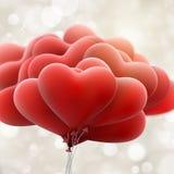 Röda förälskelseballonger 10 eps Arkivfoton