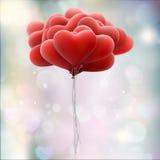 Röda förälskelseballonger 10 eps Arkivbilder