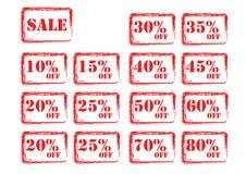 röda försäljningsetiketter Arkivfoto