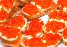 röda fiskromsmörgåsar Royaltyfria Foton