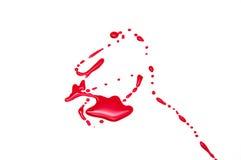 Röda fläckar på en vit bakgrund Arkivfoto