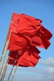 Röda flaggor Fotografering för Bildbyråer