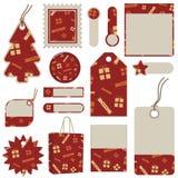 röda fliketiketter för jul Arkivfoto
