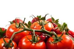 Röda frukter och grönsaker - tomat, jordgubbe, CR royaltyfria foton