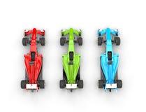 Röda, gröna och blåa bilar för formel en - bästa sikt Arkivfoto