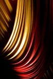 Röda & gula förhängear eller gardiner på en etapp Arkivbild