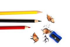 Röda, gula och svarta blyertspennor Royaltyfri Bild
