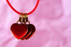 Röda hängande hjärtor Fotografering för Bildbyråer