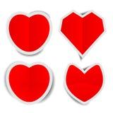 Röda hjärtapappersklistermärkear med skuggor Royaltyfria Bilder