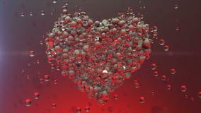 röda hjärtor Glänsande Glass bollar skapar valentinhjärta och exploderande hjärtapartiklar stock video