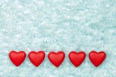 Röda hjärtor på isen Royaltyfria Foton
