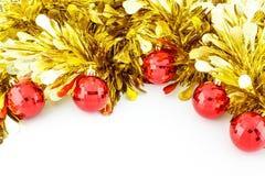 Röda julbollar och guld- glitter Fotografering för Bildbyråer