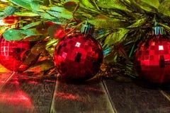 Röda julbollar och guld- glitter på trä Fotografering för Bildbyråer