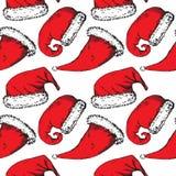 Röda juljultomtenhattar på vit bakgrund royaltyfri illustrationer
