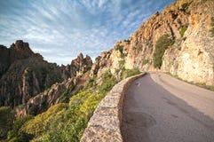 Röda klippor i Corsica Arkivbild