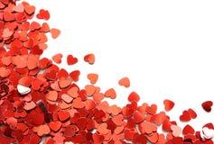 röda konfettihjärtor arkivfoton