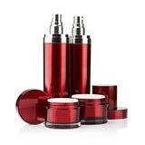 Röda kosmetiska cans Arkivbilder
