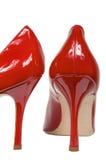 Röda kvinnligskor royaltyfri foto