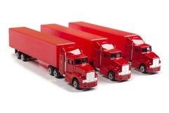 röda lastbilar Royaltyfri Foto