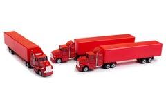 röda lastbilar Arkivbild