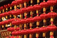 Röda lyktor för kinesisk beröm för nytt år arkivfoto