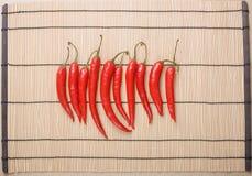 röda matta peppar för chiligrupp Royaltyfria Bilder