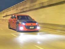 Röda Mazda 3 skräddarsy Fotografering för Bildbyråer