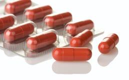 Röda medicinska pills Fotografering för Bildbyråer