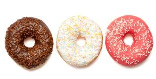 Röda och bruna donuts för vit, Fotografering för Bildbyråer