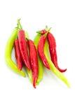 Röda och gröna chilipeppar Royaltyfri Bild