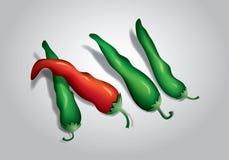 Röda och gröna chilipeppar Arkivfoto