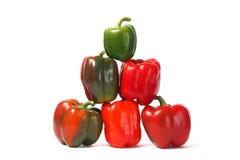 Röda och gröna spanska peppar royaltyfri bild