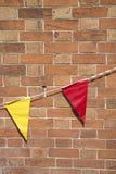 Röda och gula flaggor Royaltyfria Foton