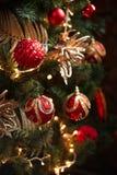 Röda och gula garneringar för julträd Royaltyfria Bilder